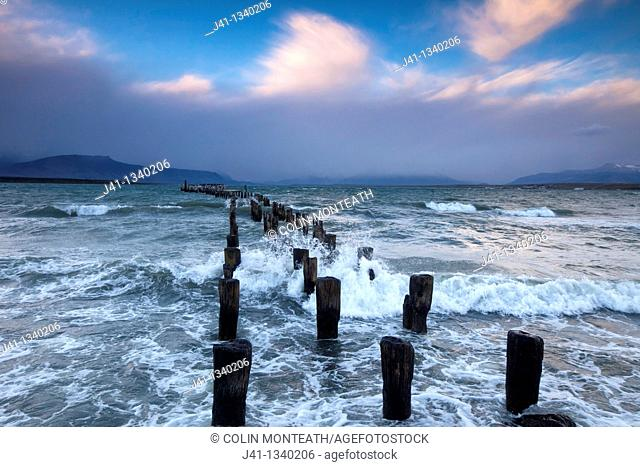 'Braun & Blanchard' famous old pier, storm approaching at sunset, Puerto Natales, Patagonia, Chile