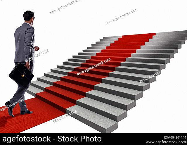 Young businessman climbing stairs and red carpet on white background