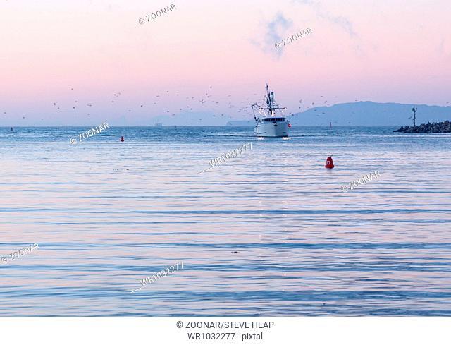 Fishing boat entering Ventura harbor dawn