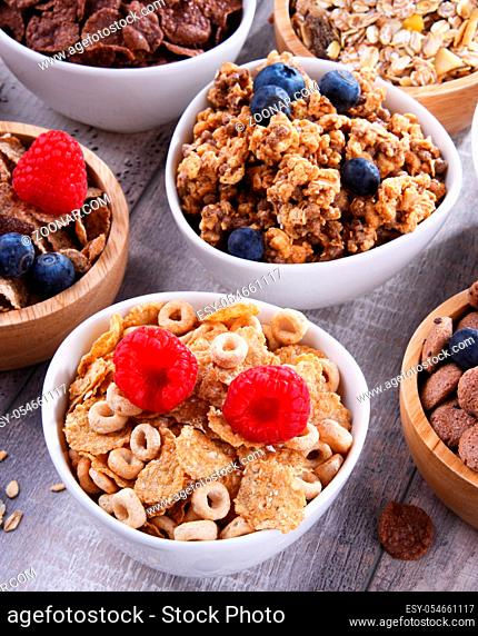 Bowls containing different sorts of breakfast cereal products