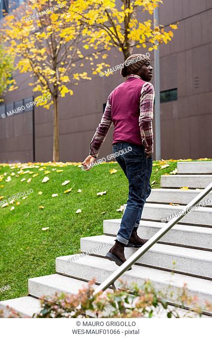 Man walking upstairs