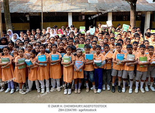 Students celebrate as they get their new textbooks for new classes on Thursday at Narayanganjs Rupganj. -- The Textbook Festival is celebrated in all the...