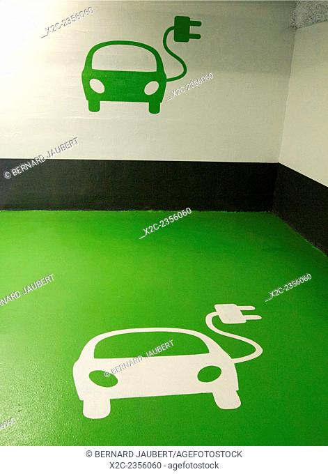 Electric car charging point logo on the floor of charging point parking space