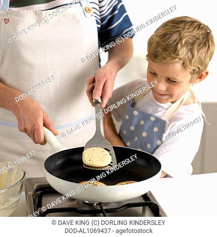 Flipping pancakes in a frying pan