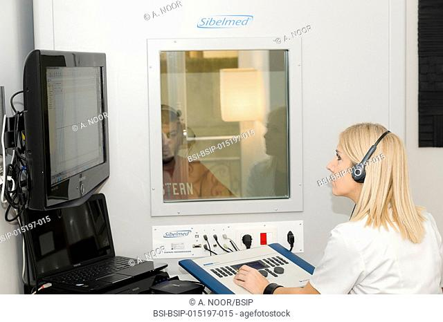 Reportage on an ENT doctor in Nice, France, treating patients suffering from dizziness. A 37-year old patient during hearing tests in a booth