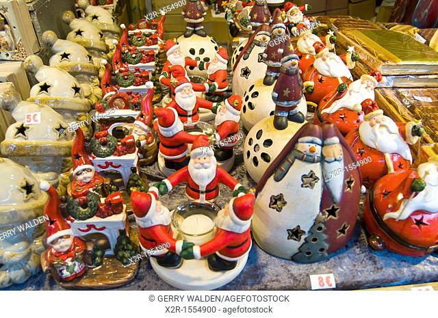 Christmas street market stall in the centre of Brugge, Flanders, Belgium showings various seasonal items on sale