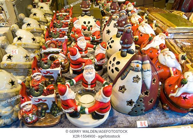 Christmas street market stall in the centre of Brugge, Flanders, Belgium showings various seasonal items on sale