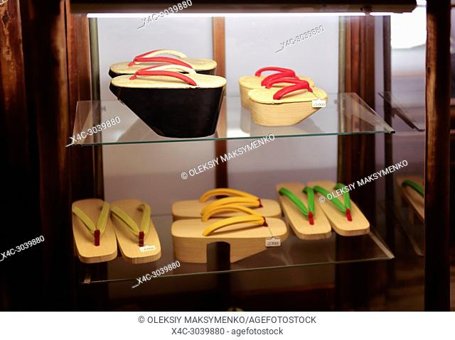 Expensive vintage traditional Japanese wooden geta shoes on a store display in Gion Kyoto Japan