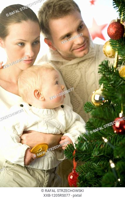 parents with infant during christmas
