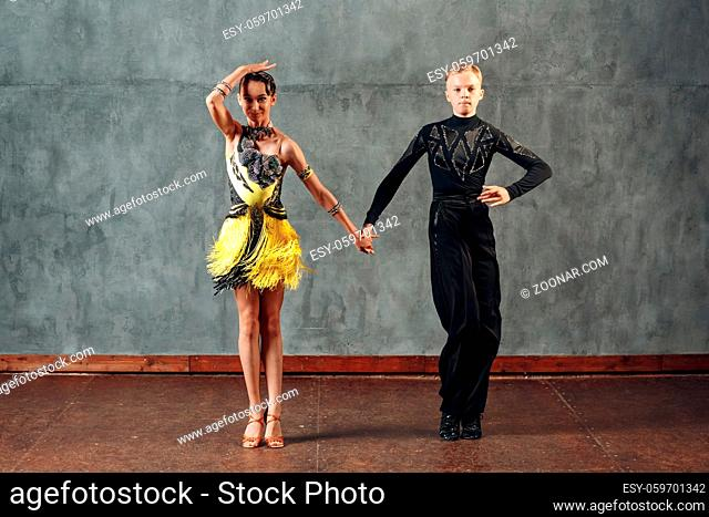 Young couple dancers dancing ballroom dance cha-cha-cha