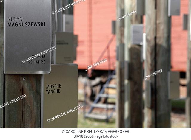 Posts with name tags of Jewish prisoners in front of a carriage used to transport the prisoners, memorial at Hessental Concentration Camp, Schwaebisch Hall