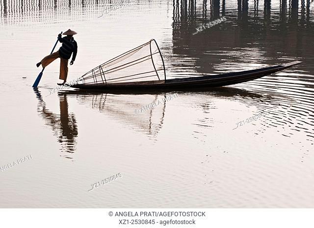 Fisherman on boat, Inle lake, Myanmar