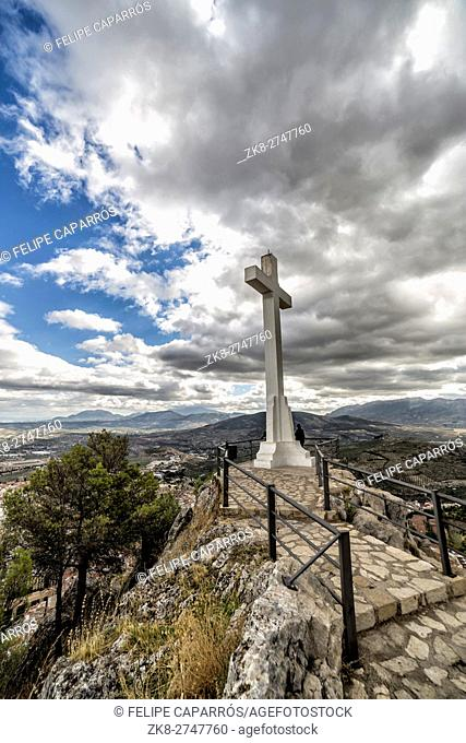 Landmark of walkway towards great crucifix in Santa Catalina or St Catherine mountain, public monument and lookout balcony over Jaen city, Andalusia, Spain