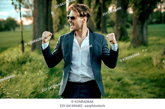 Portrait of a handsome, young businessman close to the nature