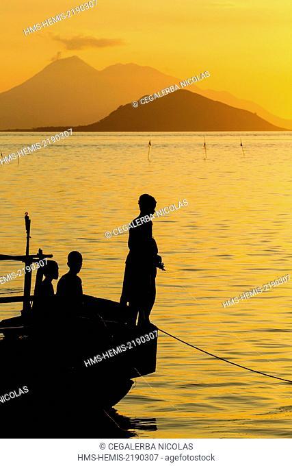 Indonesia, Lesser Sunda Islands, Alor archipelago, Pantar Island, Kabir, youngs fishing at the sunset with in back ground Batang Island and Lambata Island