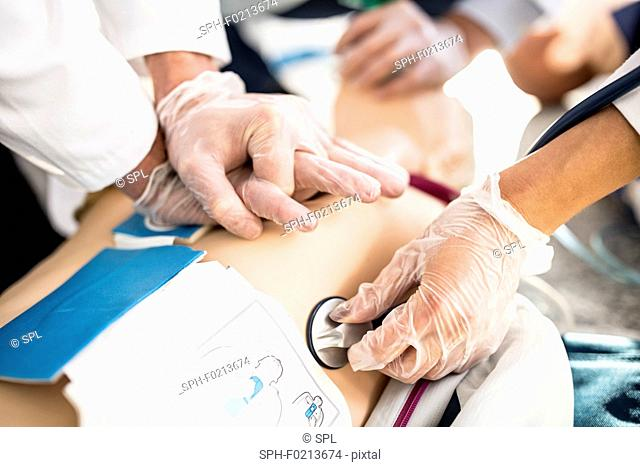 Doctors undertaking CPR training