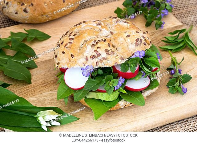 Vegetarian burger with ground-ivy, bear's garlic, dandelion and other wild edible plants