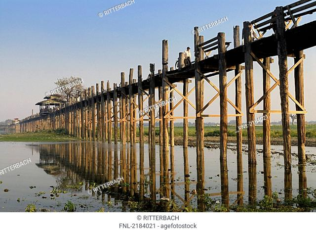 Wooden bridge across lake, U Bein Bridge, Taungthaman Lake, Amarapura, Mandalay, Myanmar