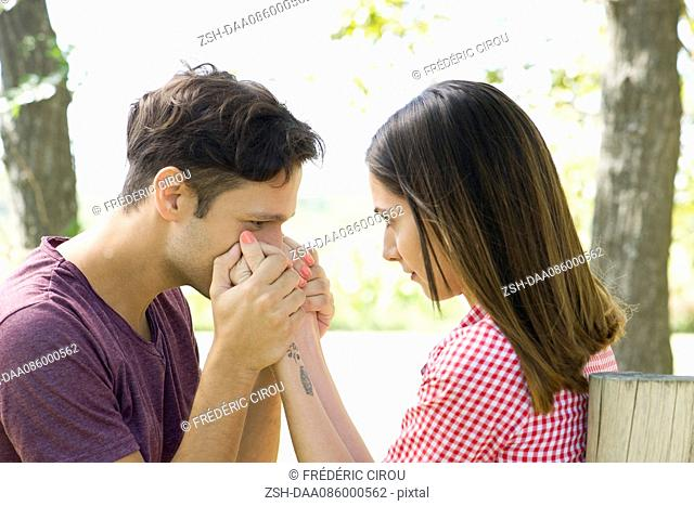 Man kissing wife's hand
