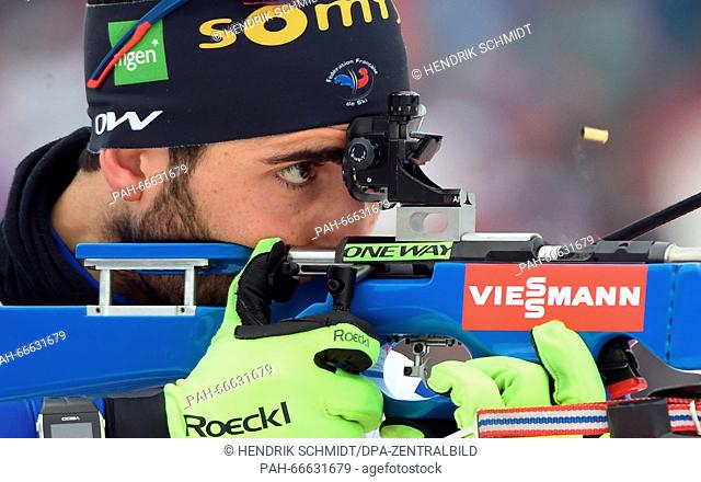 Biathlete Martin Fourcade of France at the shooting range during the Men's 4x7.5 km relay competition at the Biathlon World Championships