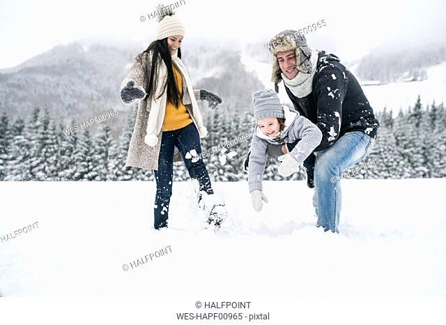 Happy family in winter landscape