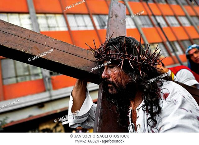 A Peruvian actor Mario Valencia, known as Cristo Cholo, performs as Jesus Christ in the Good Friday procession during the Holy week in Lima, Peru, 30 March 2013