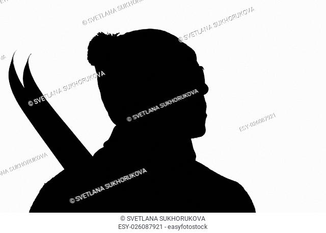 Black silhouette of a man's shoulder portrait in profile of a ski hat with skis on a white background