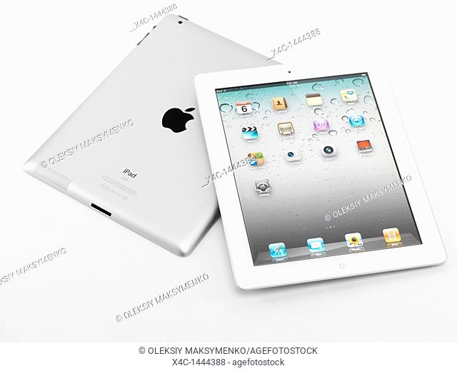 Two Apple iPad 2 tablet computers isolated on white background