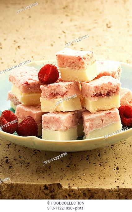 Cubes of coconut and raspberry ice cream with fresh raspberries