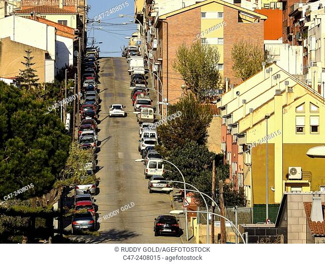 Parked cars in a steep street. EL Masnou, Maresme, Barcelona province, Catalonia, Spain