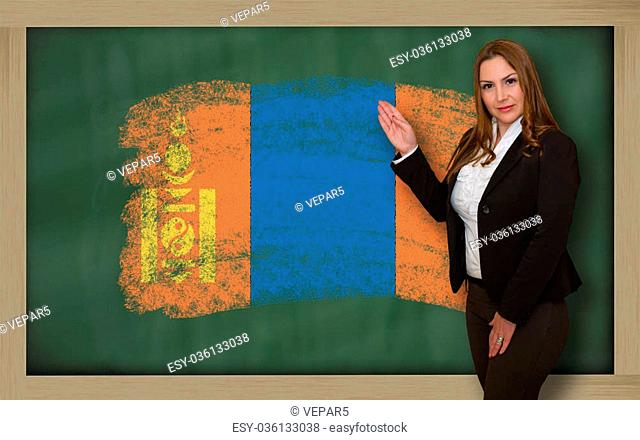 Successful, beautiful and confident woman showing flag of mongolia on blackboard for marketing research, presentation and tourist advertising