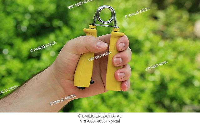 Rehabilitation with tension hand grip exerciser