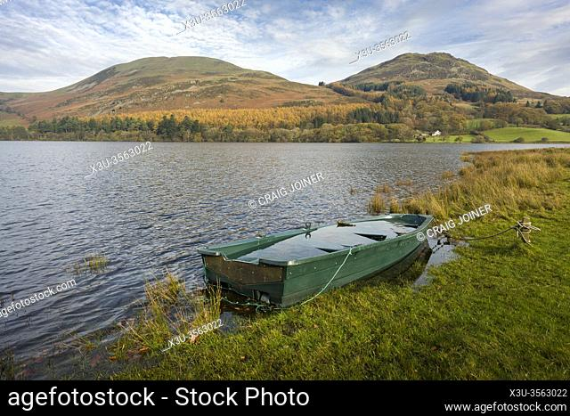 The shore of Loweswater with Darling Fell and Low Fell beyond in the Lake District National Park, Cumbria, England