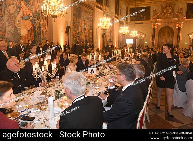 15 February 2020, Bavaria, Munich: Guests sit at the traditional dinner for the participants of the Munich Security Conference in the Kaisersaal of the Munich...