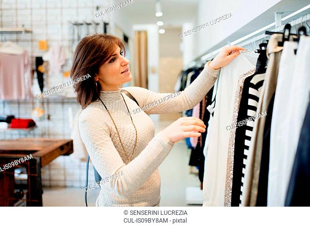 Woman shopping in fashion boutique