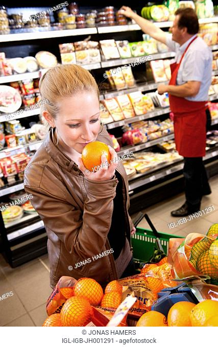 Client walking and choosing goods and food fruits in a supermarket