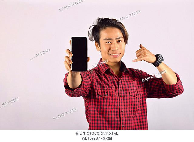 Young male model with mobile phone, Pune, Maharashtra