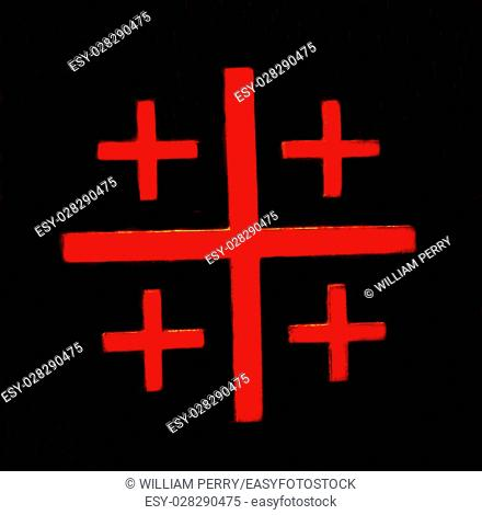 Red Crusader Cross Black Background Church of the Nativity Bethlehem West Bank Palestine. Chruch located above cave/grotto where Jesus was born