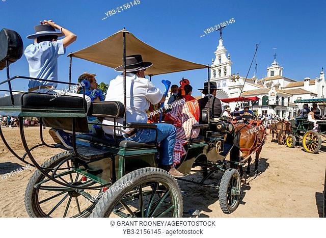 People Being Transported In A Traditional Wagon, El Rocio Festival, El Rocio, Andalusia, Spain