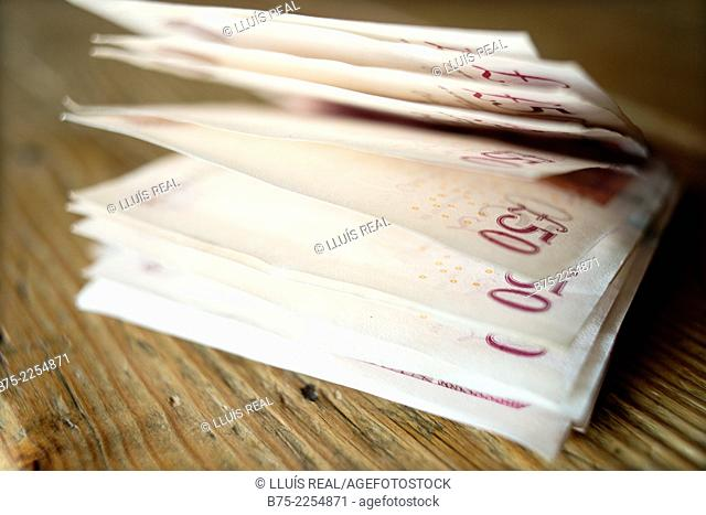 Close-up of several banknotes of 50 pounds