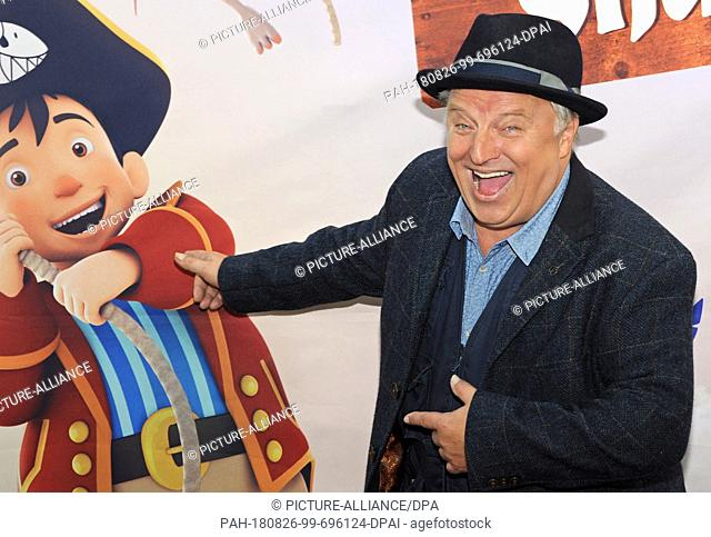 """26 August 2018, Germany, Munich: The actor and dubbing artist Axel Prahl arrives for the film premiere of the animated film """"""""Captain Sharky"""""""""""