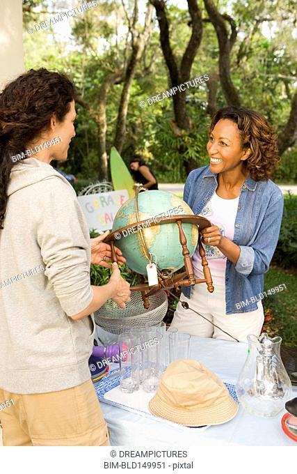 African American woman having a garage sale