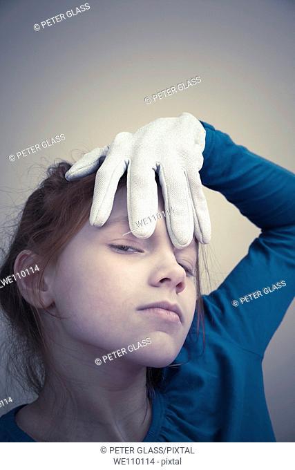 Preteen redhead girl wearing a white glove