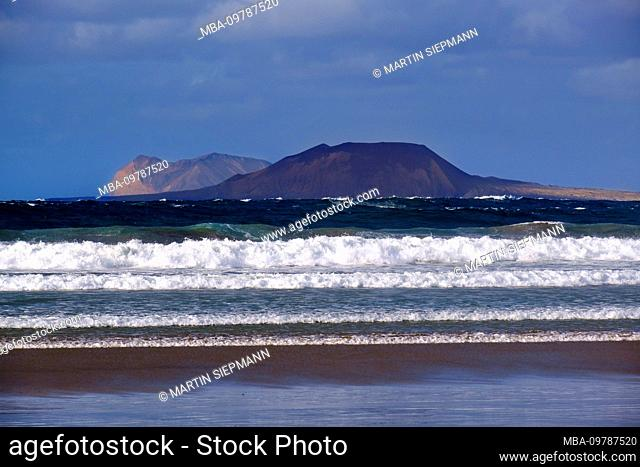 Sea waves, at Caleta de Famara, behind La Graciosa island, Lanzarote, Canary Islands, Spain