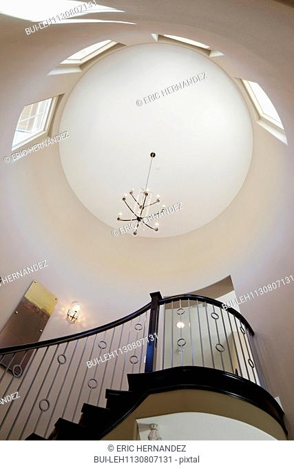 Low angle view of staircase and circular ceiling; Valencia; California; USA