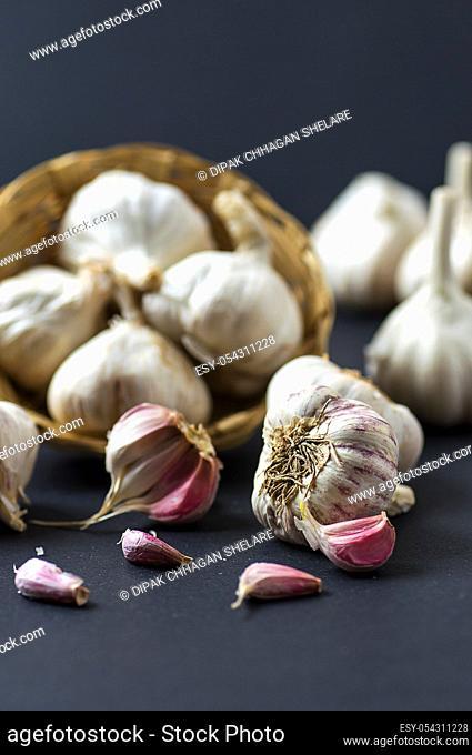 Garlic Cloves and Garlic Bulb in Basket
