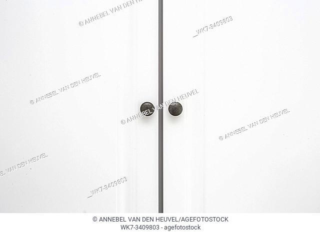 White wooden Closet doors close up background texture modern design