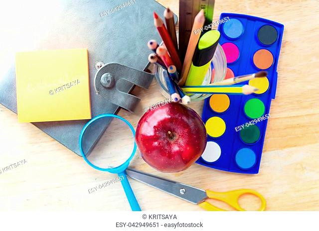 Education school tools,studies accessories on Wood Background