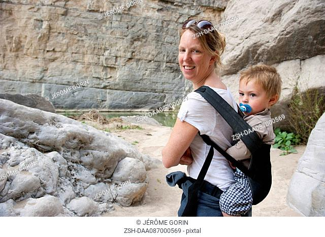Woman hiking with young son at Big Bend National Park, Texas, USA