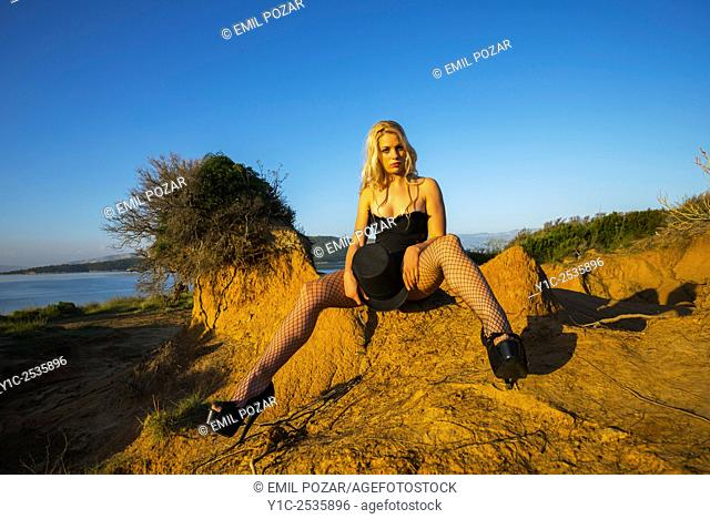 Beautiful young woman in sunset light in wilderness